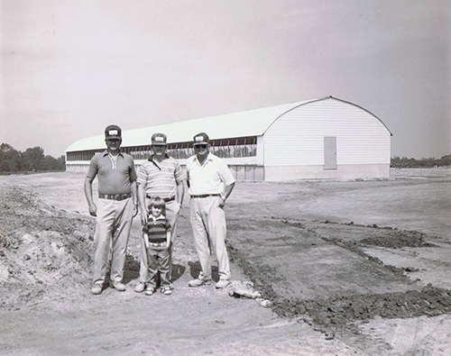 Hog Slat - The Waller Family with Hog Slat's first turnkey construction project built in 1982.