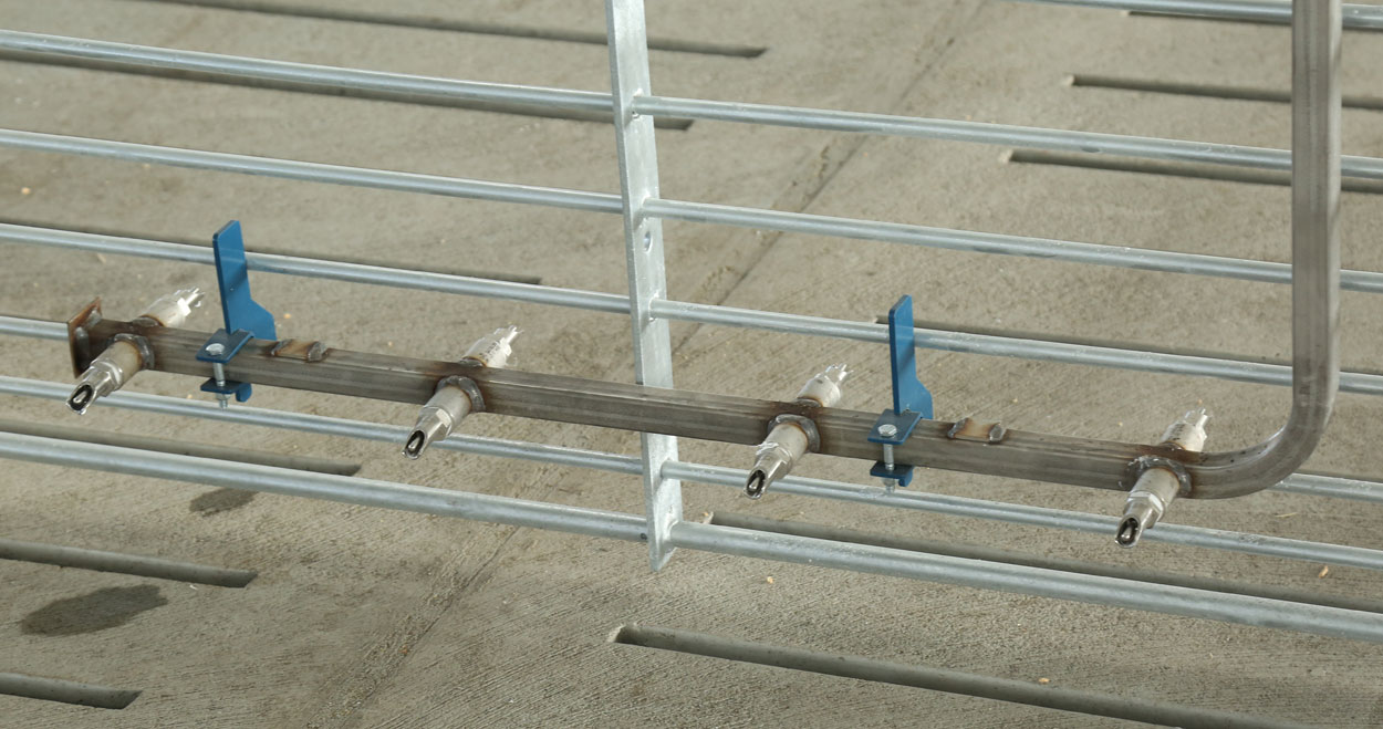 The Hog Slat nursery pig nipple bar provides weaned pigs with an additional, easy to access water source when starting new groups on wet/dry feeders. (Shown: 8 nipple bar model with painted mounting hook kit.)